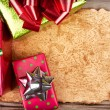 Stock Photo: Torn paper on wooden background with Christmas presents