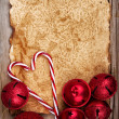 Stock Photo: Torn paper on wooden background with ornaments