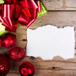 Stock Photo: White torn paper on wooden background Christmas ornaments