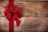 Christmas ribbon on wooden background — Stockfoto