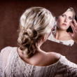 Woman looking into a broken mirror — Stock Photo #39253609