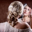Woman looking into a broken mirror — Foto Stock