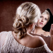 Stock Photo: Womlooking into broken mirror