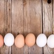Stock Photo: Brown and white eggs lined up