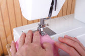 Sewing on sewing machine — Stock Photo