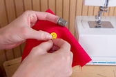 Sewing on a button — Stock Photo