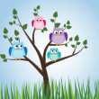 Owls sitting in a tree — Stock Vector #41515953
