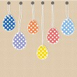 Easter eggs hanging from strings — Stock Vector