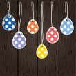 Easter eggs hanging from strings — Stock Vector #41516565