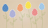 Easter eggs on flower stems — Stock Vector