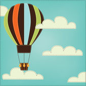 Vintage or retro hot air balloon in sky with clouds — Stock Vector