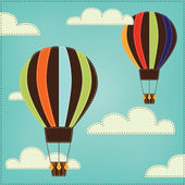 Vintage or retro hot air balloon in sky with clouds — Vecteur