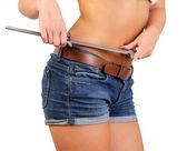 Woman measuring perfect shape of beautiful waist — Stock Photo