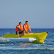 Ride a banana boat — Stock Photo
