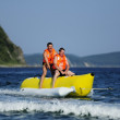 Ride a banana boat - Stock Photo