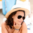 Woman with hat having fun in summer vacation on beach — Stock Photo