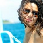 Young sexy woman in white bikini enjoying the sunset — Stock Photo #32143473