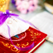 Wedding rings on a cushion with holy bible underneath — Stok fotoğraf