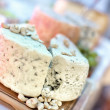 Blue cheese close-up as appetiser with various types of cheese — Stock Photo