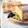Close-up of Various types of cheese as appetiser at vintage part — Stock Photo #32144313