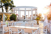 Beautiful restaurant with terrace on ocean shore — Stock Photo