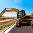 Stock Photo: Excavator working on road construction site