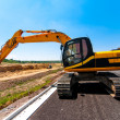 Excavator working on road construction site — Stock Photo #32150819