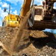 Heavy duty construction excavator moving earth — Stock Photo