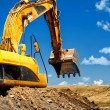 Stock Photo: Yellow, heavy duty excavator moving soil