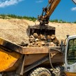 Heavy duty construction vehicles, moving stones — Stock Photo