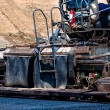 Qualified engineer operating asphalt paver machine — Stock Photo