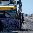 Industrial pavement machine laying fresh asphalt on new highway — Stock Photo