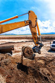 Industrial construction site with working excavator — Stock Photo