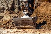 Close-up da escavadeira em stand by no canteiro de obras — Foto Stock