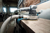 Power buffer machine used for polishing cars in auto workshop — Stock Photo