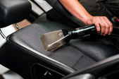 Auto car service cleaning the drivers seat, cleaning and vacuuming leather — Stock Photo