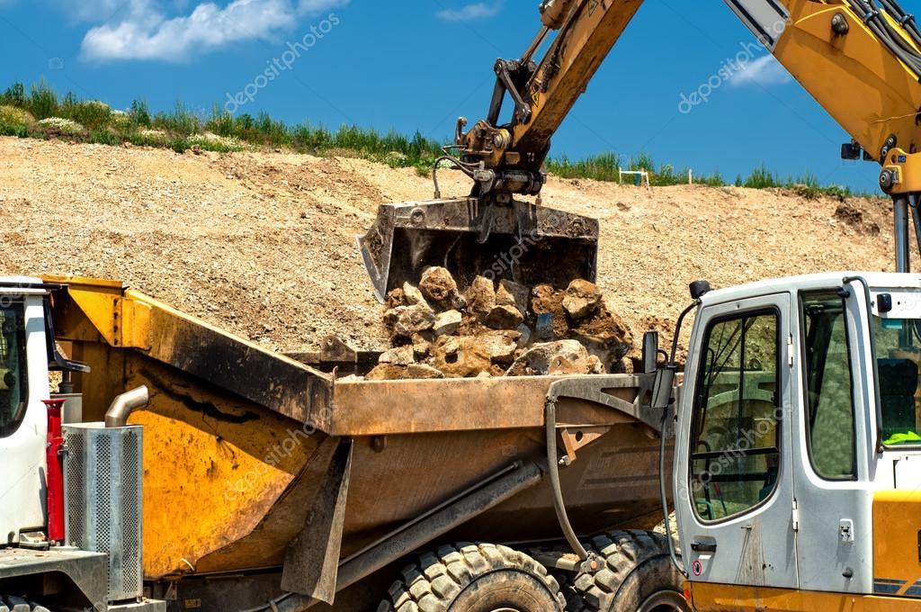 Heavy Duty Construction : Heavy duty construction vehicles moving stones — stock
