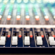Close-up of music controls buttons of studio mixer — Stock Photo #32177323