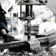 Stock Photo: Industrial engineer working on drilling machine, making hole