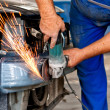 Professional welder in factory making changes on body car — Stock Photo #32177645
