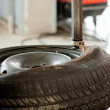 Stock Photo: Wheel repair in auto service garage