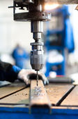 Industrial worker using a mechanical drill machine — Stock Photo