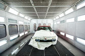 Car paint garage with car inside — Stock Photo