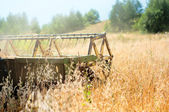 Wheat Grain Harvesting Machinery collecting late summer harvest in local crops — Stock Photo