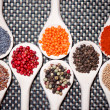 Assortment mix of colorful spices with chopped parsley, mustard seeds, green, black and red chili pepper — Stock Photo #32844237