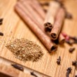 Milled cinnamon and cinnamon sticks, tea ingredients. detail view — Stock Photo