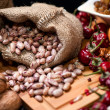 Stock Photo: Bio onions, nuts, beans and dried pepper as food ingredients on kitchen table