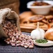 Winter ingredients such as bean seeds, onions and garlic or dried hot spicy pepper — Stock Photo