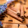 Detail view of cinnamon sticks, lavander and other tea ingredien — Stock Photo