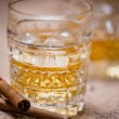 Close-up of whiskey glass on the rocks with cigars and vintage background — Stock Photo